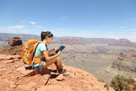 girl travelling, with a tablet device